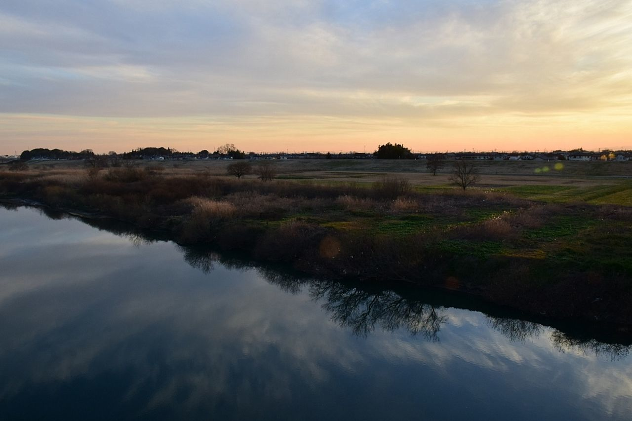 nature, scenics, beauty in nature, sky, tranquil scene, tranquility, water, sunset, outdoors, landscape, cloud - sky, no people, field, tree, day