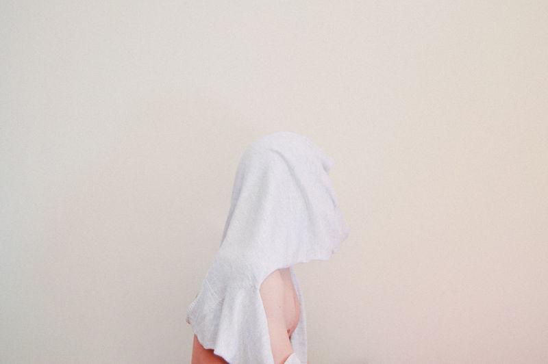Towel Over Figurine Against Beige Background