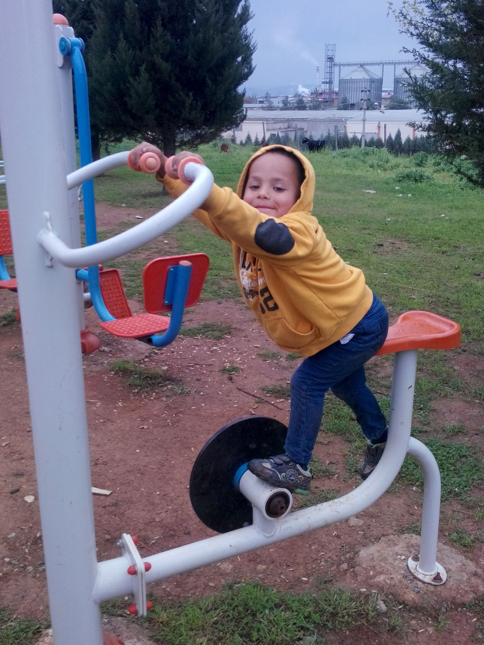 person, lifestyles, leisure activity, casual clothing, childhood, full length, happiness, elementary age, smiling, young adult, portrait, looking at camera, park - man made space, fun, playground, girls, enjoyment, front view