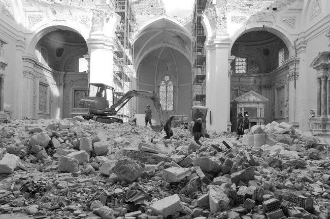 L'Aquila earthquake: firemen on the ruins inside the church of Collemaggio Abruzzo L'Aquila Rubble Wall Arch Architectural Column Architecture Black And White Blackandwhite Built Structure Church Architecture Digger Earthquake Earthquake In Italy Earthquake L'aquila Firemen Firemen At Work Full Length Indoors  Italy Place Of Worship Real People Religion Ruin Church Spirituality
