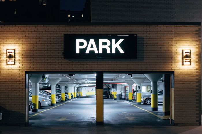 Car hole Communication Guidance Text Illuminated Built Structure Architecture Parking Lot Direction Transportation Night Parking Sign Exit Sign Indoors  Information Medium Road Sign No People Parking Garage City Building Exterior Neon EyeEm Best Shots The Street Photographer - 2017 EyeEm Awards