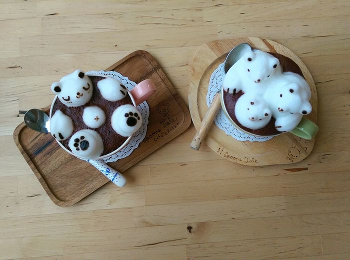 Panda Shaped Sugar Cubes In Hot Chocolates On Wooden Table