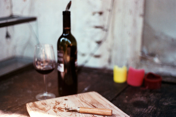 Wine Time Agfavista400 Alcohol Analogue Photography Bottle Bottle Of Wine Candle Candles Close-up Colour Photography Film Photography Food And Drink Indoors  Nikon F3 No People Table Wine Wine Glass Wine Moments Wine Opener Wine Tasting Wood - Material Wooden Board