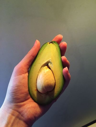 Human Hand Human Body Part Holding Fruit Healthy Eating Food One Person Food And Drink Human Finger Freshness SLICE Close-up Real People Indoors  Day People Freshness Avocado