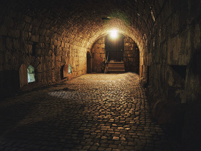 Architecture The Way Forward Direction Built Structure Arch Cobblestone Illuminated Building Lighting Equipment Wall Footpath No People Street Old Brick Stone Indoors  Night Empty Wall - Building Feature Alley Paving Stone Stone Wall Long