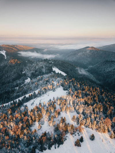 High angle view of snow covered landscape against sky