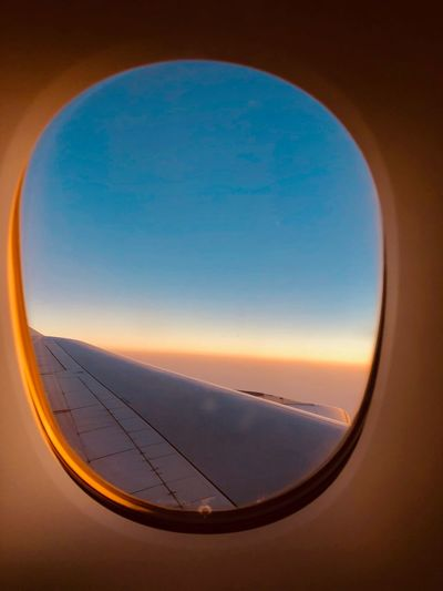 Flying over Asia Sky Sunset Airplane Air Vehicle Glass - Material Nature Window Mode Of Transportation Cloud - Sky Aircraft Wing