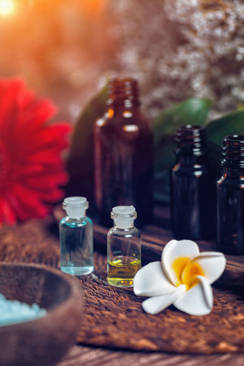 Aromatherapy Aromatherapy Aromatherapy Oil Essential Oils Orange Red Bottles Spa Wellness Relax Glass Therapy Sea Salt Blue Natural Aromatic Brown Care Treatment Healthy Perfume Candles Essence Green Fragnance Organic Health Aroma Fresh Alternative Relaxation Lifestyle Decoration Cosmetic Ingredient Skincare No People Flower Bottle Close-up Wellbeing Body Care Table