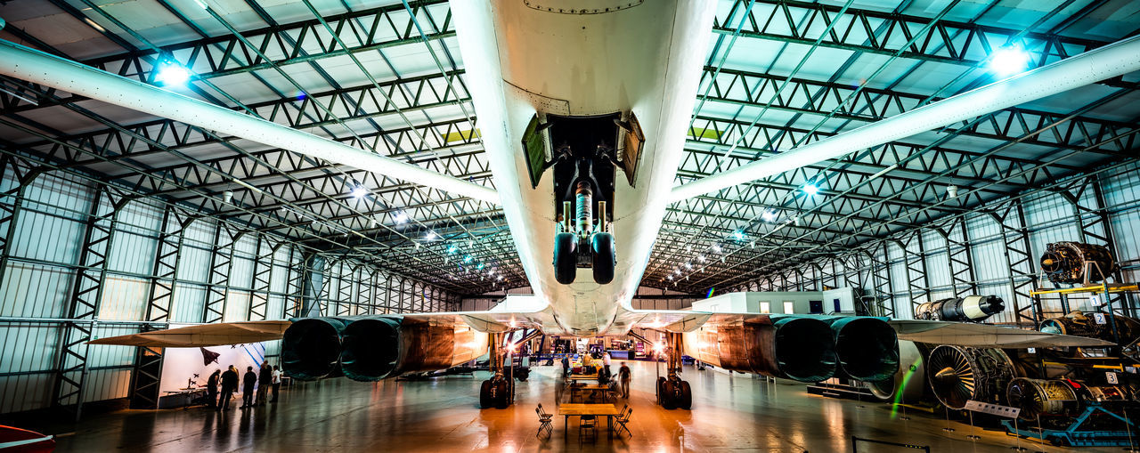 Underside view of Concorde inside an aircraft hangar. Aeroplane Concorde Hangar Plane Supersonic Plane Aerospace Industry Air Vehicle Airplane Airport Architecture Built Structure Factory Flight Indoors  Landscape Mode Of Transportation Supersonic Technology Transportation Travel Warehouse Wings