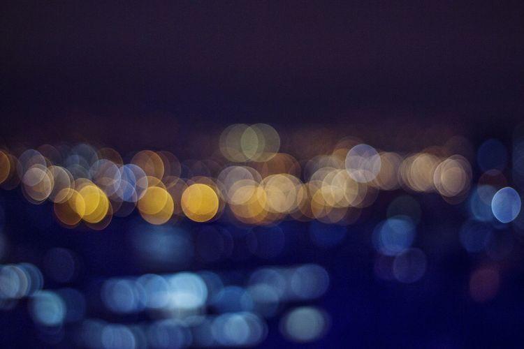 Defocused Image Of Lights At Night