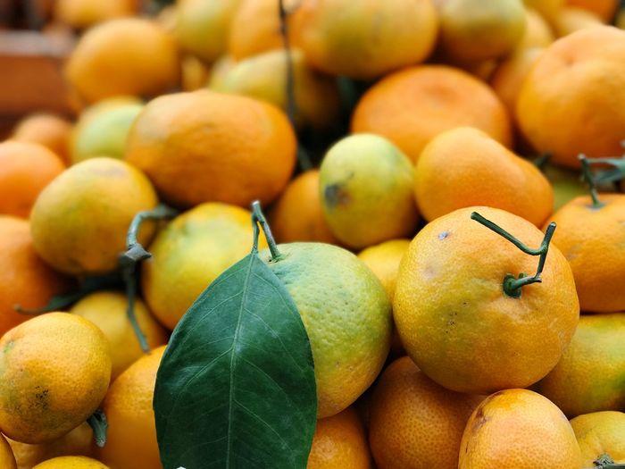 Full frame shot of oranges for sale at market