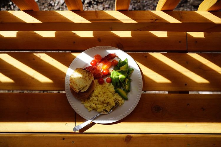 Colour Of Life colorful healthy food and the cabin deck during Sunrise > GoodLiving Eat Breakfast Outdoors