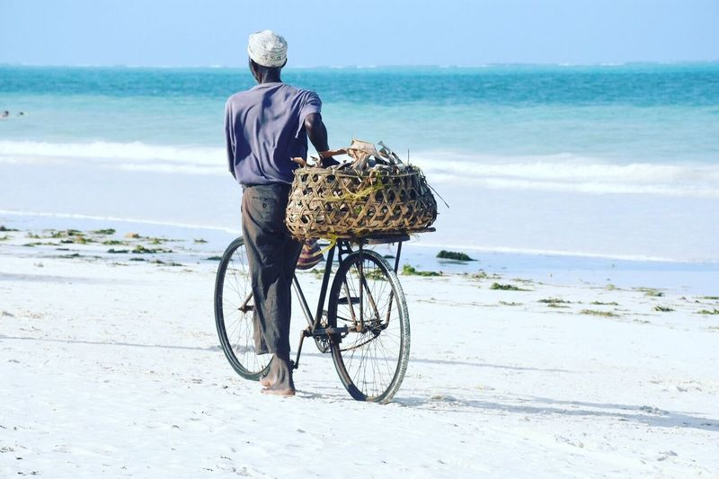 Sea Water Beach Horizon Over Water Real People Horizon My Best Travel Photo Rear View Bicycle Beauty In Nature Casual Clothing Transportation Sky One Person Full Length Land Nature Lifestyles Outdoors