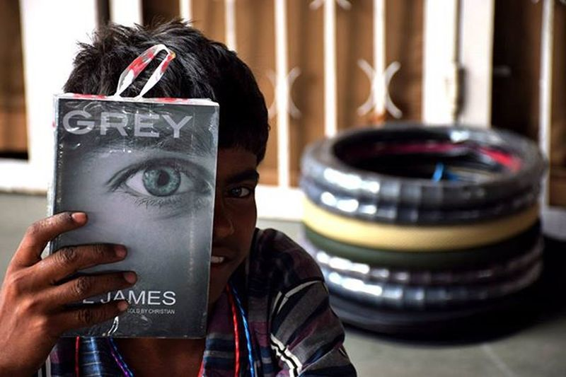 For the tamron Contest.. TPSTamron @thephotosociety The Darker Shades Of Grey.. The photo depicts the dark parts of India. The children in India instead of studying are busy selling the books. This boy was holding the book which can be easily associated with his Life. I Wish these children get in the right track and instead of just selling these books, also get a chance to read them too.
