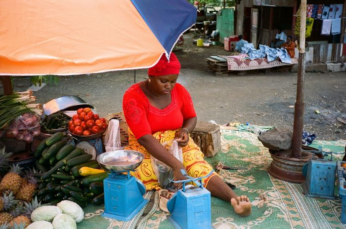 Adult Adults Only Business Consumerism Day Food Food And Drink Freshness Fruit Healthy Eating Market Market Stall Market Vendor Occupation One Man Only One Person Outdoors People Real People Retail  Selling Small Business Vegetable Working