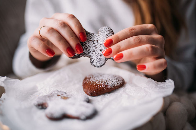 Cropped Hands Of Woman Holding Gingerbread Cookie