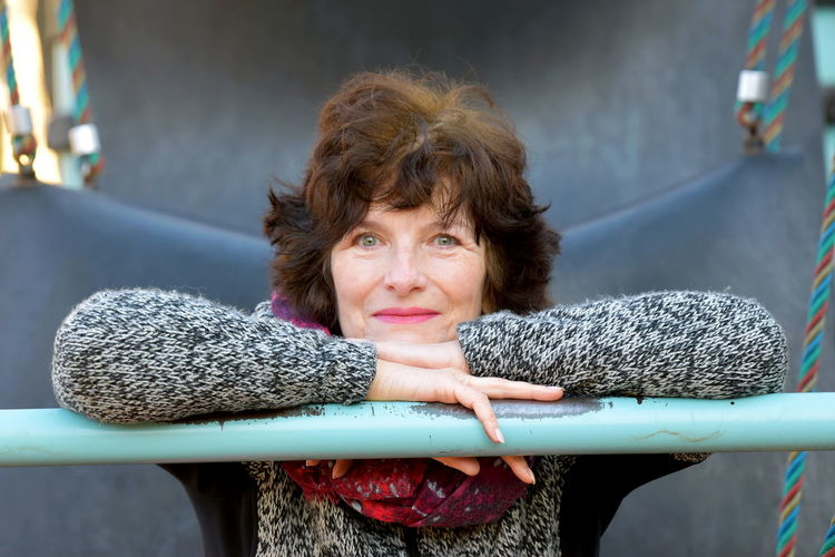Portrait of smiling mature woman by railing