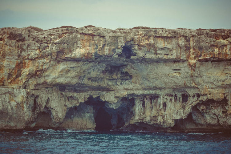 Sky Scenics - Nature Beauty In Nature Tranquility Tranquil Scene No People Nature Outdoors Seascape Landscape Rocks Geology Sea Water Rock Formation Rock Waterfront Solid Rock - Object Day Physical Geography Cliff Eroded Stack Rock Seacave