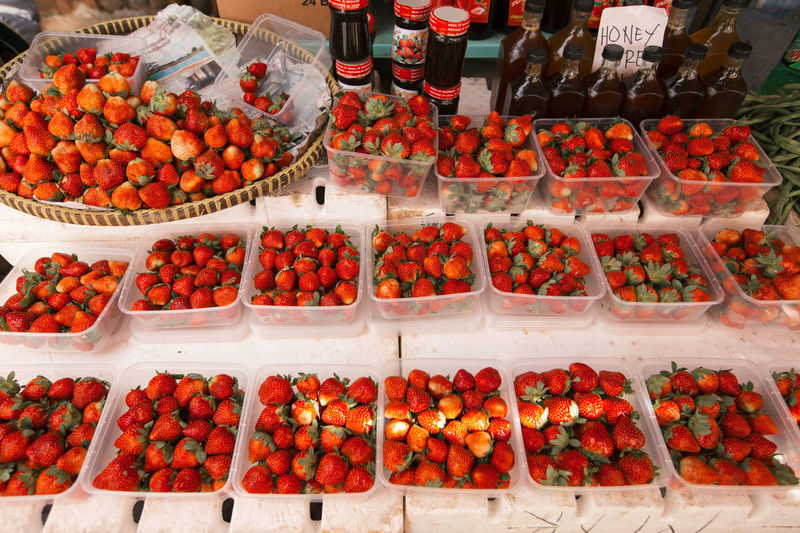 Strawberries In Containers For Sale At Market Stall