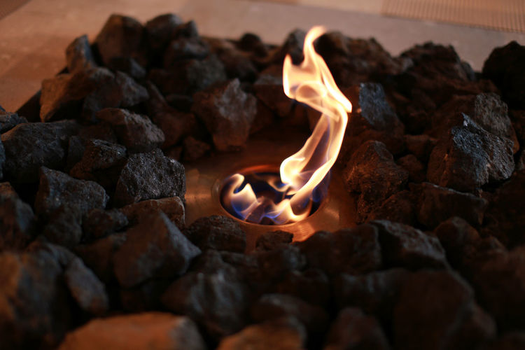 Modern fireplace, close up Fuel Gas Rock Wintertime Ash Burning Burnt Close-up Coal Fire Fire - Natural Phenomenon Fireplace Flame Glowing Heat - Temperature Log Motion Nature No People Orange Color Rock Rock - Object Solid Warm Autumn Mood