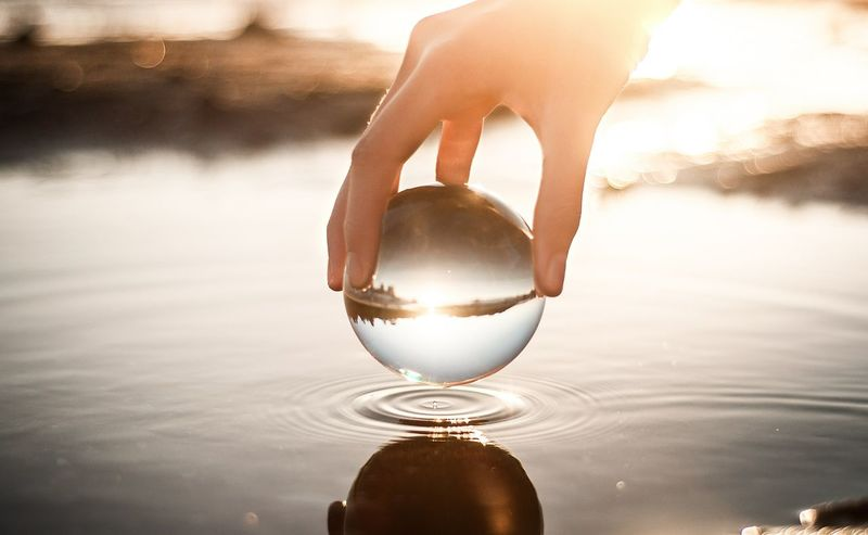 Peace Water Reflection Refreshment Liquid Drink Human Body Part Sunset Close-up Alcohol Nature Outdoors Beach People Adult Freshness Day Sky Adults Only One Person Human Hand