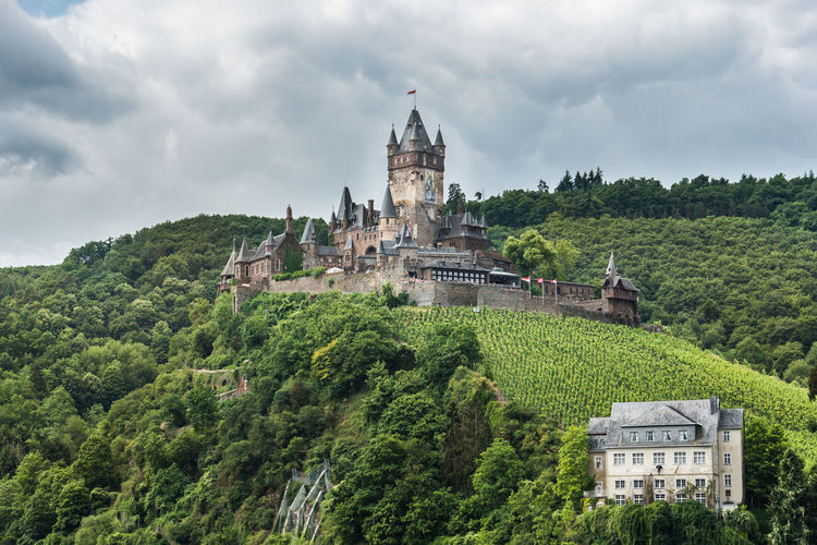 Low angle view of cochem imperial castle on mountain