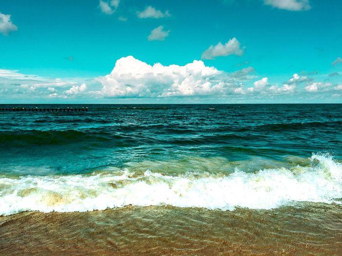 Sea Beauty In Nature Water Wave Nature Scenics Horizon Over Water Sky Surf Tranquil Scene Tranquility No People Beach Outdoors Day Idyllic Cloud - Sky Motion EyeEm Best Edits EyeEm Gallery The Week On Eyem EyeEm Best Shots