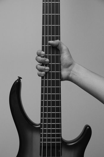 Bass handling Arts Culture And Entertainment Bass Bass Guitar Blackandwhite Close-up Day Electric Guitar Fretboard Guitar Human Body Part Human Hand Indoors  Music Musical Instrument Musical Instrument String Musician One Person People Playing Real People