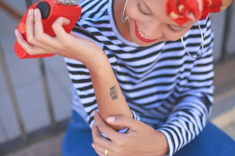 Close-Up Of Woman Looking At Tattoo