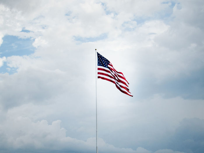 Cloud - Sky Sky Flag Patriotism Low Angle View Striped Environment Nature Wind Day Waving No People Pole Outdoors Pride Shape Red National Icon Independence EEUU