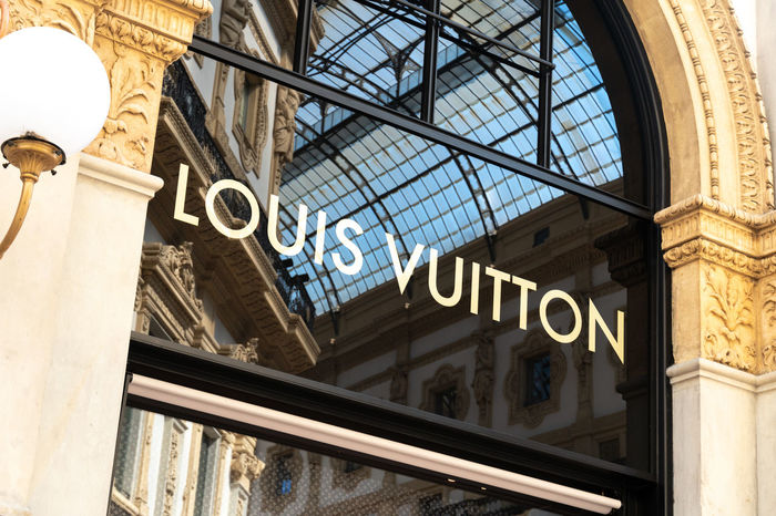 Louis Vuitton store. Shortened to LV, Louis Vuitton Malletier is a French fashion house and luxury retail company located in the Galleria Vittorio Emanuele II in Milan, Northern Italy Boutique Fashion Louis Vuitton Shopping Shopping ♡ Brand Communication Fashion Photography Fashionable French Louis Vuitton Fashion Luxury No People Retail  Shop Shopaholic Shopping Mall Store Text Vuitton
