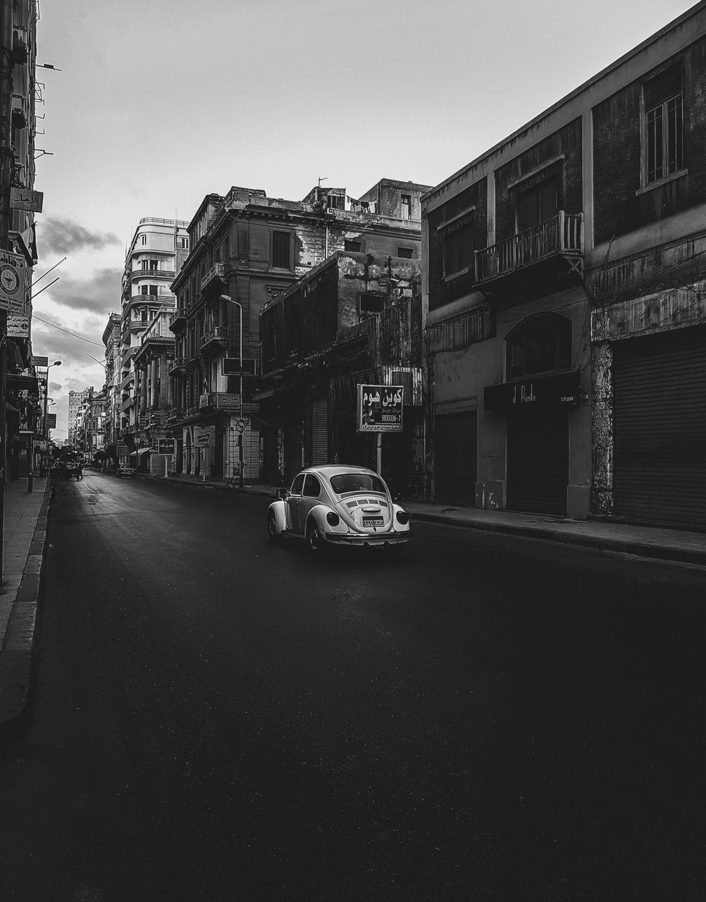 building exterior, architecture, built structure, car, transportation, street, land vehicle, mode of transport, road, city, outdoors, sky, no people, day