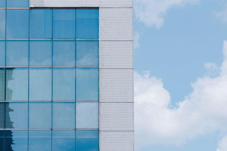 Blue windows and sky Cloud - Sky Architecture Built Structure Building Exterior Sky Building Glass - Material Window Office Building Exterior City Blue Modern Skyscraper Shape Building And Sky Square Square Shape Frame Urban Skyline Urban Geometry