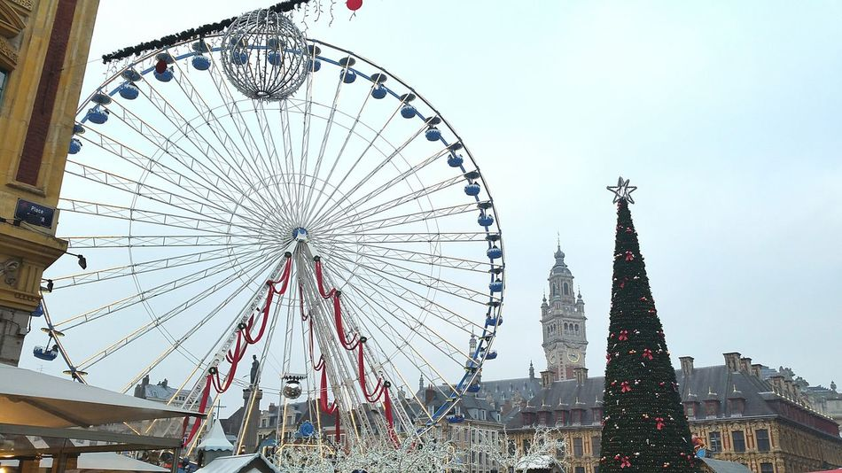 Ferris Wheel Travel Destinations City Building Exterior Belgium Christmas Tree Christmas Decorations Christmas Christmas Ball Arts Culture And Entertainment Architecture Outdoors Built Structure Sky Celebration Amusement Park Cultures No People Day Clock Tower Christmas Market