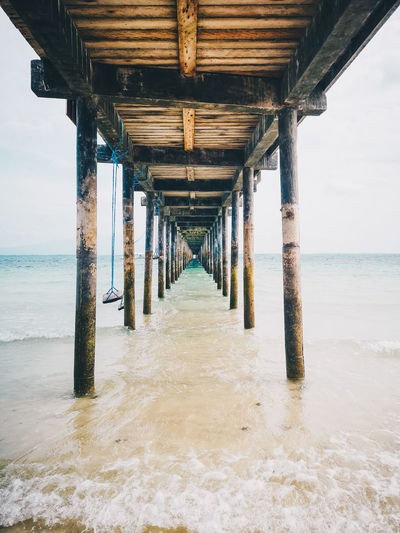 Weathered pier over sea