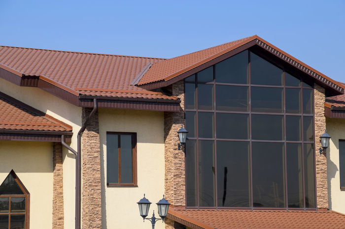 metal profile corrugated roof Architecture Building Exterior Built Structure Clear Sky Day House Metal Profile Corrugated Roof No People Outdoors Residential Building Roof Sky Tiled Roof  Window