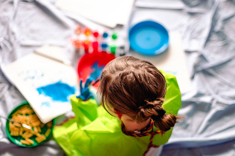 High angle view of girl painting at home