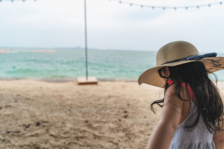let go to the beach Sea Leisure Activity One Person Water Lifestyles Real People Hat Land Women Beach Rear View Hair Focus On Foreground Day Long Hair Hairstyle Scenics - Nature Clothing Horizon Over Water Sun Hat Outdoors Holiday Pause Relaxing
