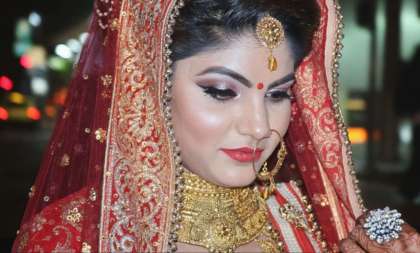 Close-Up Of Young Bride In Traditional Clothing