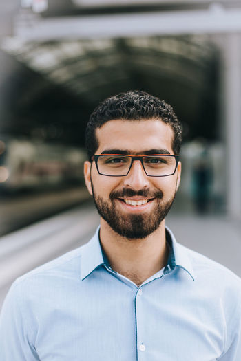 Portrait of smiling Syrian refugee man Arabian Business Glasses Integration Man Middle East Proud Refugee Stylish Syria  Syrian Refugees Travel Traveling Arab Arabic Businessman Job Portrait Professional Railroad Station Refugees Style Syrian Syrian In Germany Young Men