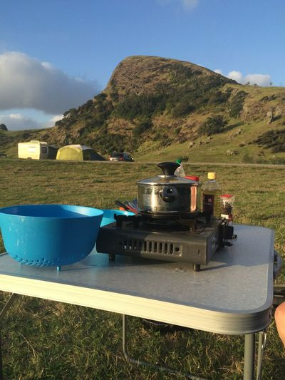 Dinner with a view Camping Dinner InTheMiddleOfNoWhere Campingdinner Cookingoutside Dinnerwithaview Grass Mountain Mountain Range Mountains Nature Newzealand No People Outdoors Sky Table