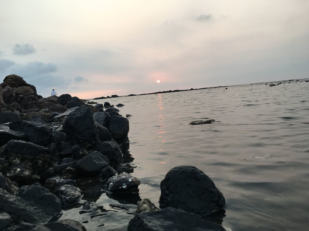 sunset, sea, water, nature, sky, beauty in nature, rock - object, tranquility, sun, tranquil scene, scenics, beach, cloud - sky, horizon over water, outdoors, no people, wave, day