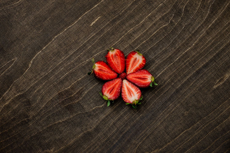 Strawberry on a dark wood background. Creative pattern concept. Food And Drink Food Freshness Red Indoors  Still Life No People Strawberry Strawberries Fruit Fruits Fresh Healthy Eating Vehetable Natural Raw Vitamin Raw Food Tasty Breakfast Ripe Juicy Sweet Berry Delicious Nutrition Background Rustic Dessert Freshness Eating Organic Close-up Diet Ingredient Vegan Snack Apperitive Pattern Dark Wooden Table Brown Texture Textured  Bowl Plate Ceramic Flat Flat Lay High Angle View Flower Directly Above Plant Flowering Plant Wood - Material Beauty In Nature Nature Flower Head Textured  Wood Grain