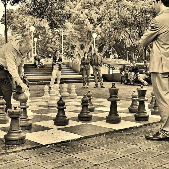 Playing a game of chess during lunch hour break at Sydney's Hyde Park. Traveltheworld Australia Sydney Chess Lunchbreak Downunder