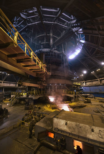 High Angle View Of Worker Working At Steel Mill