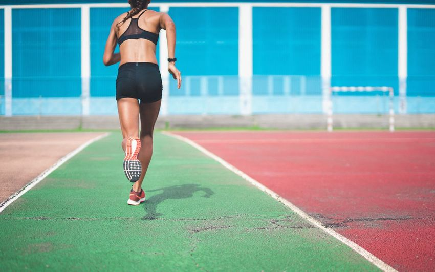 Lifestyles Sports Clothing Running Real People Sport One Person Exercising Healthy Lifestyle Motion Rear View Focus On Foreground Leisure Activity Vitality Women Day Outdoors Activity Running Track Athlete Sports Track Woman Active Woman Fitgirl
