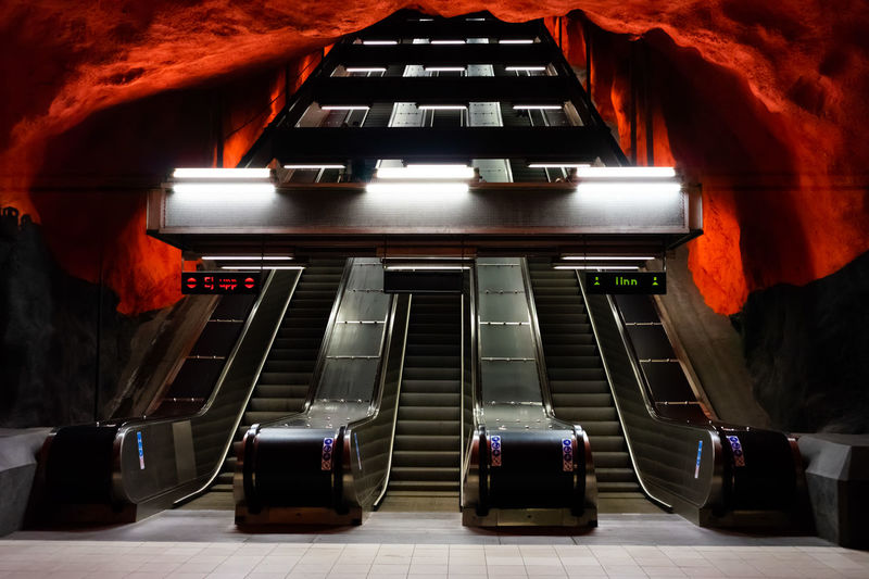Centrum Stockholm, Sweden Absence Architectural Column Architecture Arts Culture And Entertainment Built Structure Escalator Flooring Illuminated In A Row Indoors  Mode Of Transportation No People Orange Color Public Transportation Rail Transportation Red Seat Solna Subway Transportation Travel Travel Destinations The Architect - 2018 EyeEm Awards