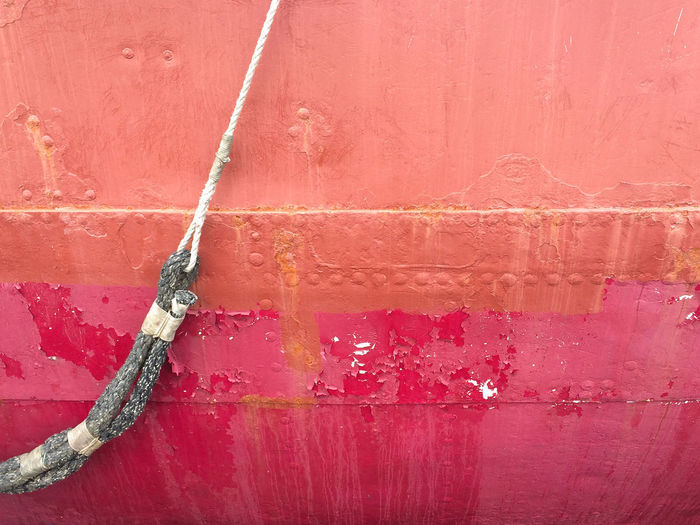 Red Wall - Building Feature Backgrounds Built Structure Full Frame No People Textured  Old Weathered Damaged Paint Metal Rope Ship
