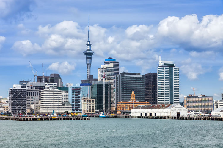 Skyline of Auckland, New Zealand. Auckland Business Business Finance And Industry Cityscape Coastline Commercial Dock Downtown District Downtown Economy Ferry Finance Front View Futuristic Modern Architecture New Zealand North Island Oceania Panorama Pier Quay Sky Tower Sea Skyline Urban Urban Skyline Urban Geometry Urbanphotography Travel Destinations Tourism Communications Tower Town TOWNSCAPE Transportation Waitemata Harbour Architecture No Logos Cloudscape Day Copy Space Built Structure Building Exterior Building Sky City Water Waterfront Cloud - Sky Office Building Exterior Tall - High Skyscraper Nature Tower Travel Nautical Vessel No People Modern Spire  Outdoors Financial District