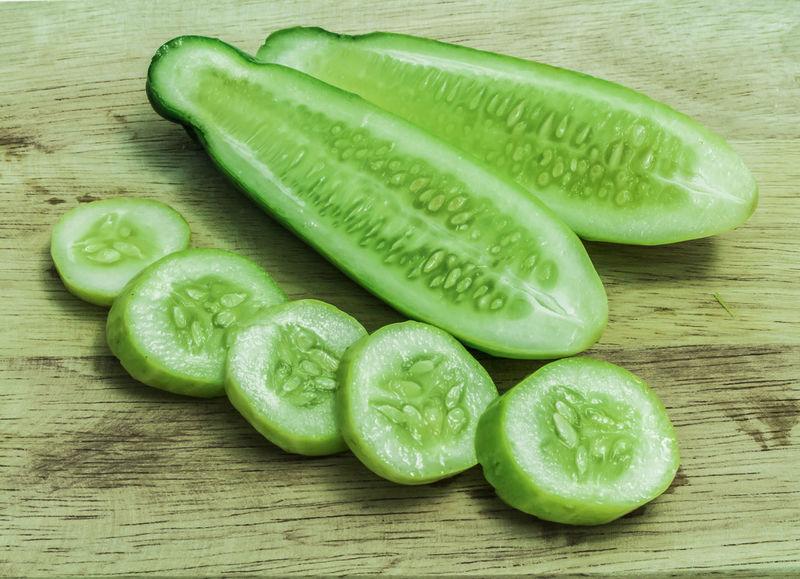 Cucumber sliced on wood Cucumber Green Nature SLICE Wood Bankground Vegetable Wallpaper